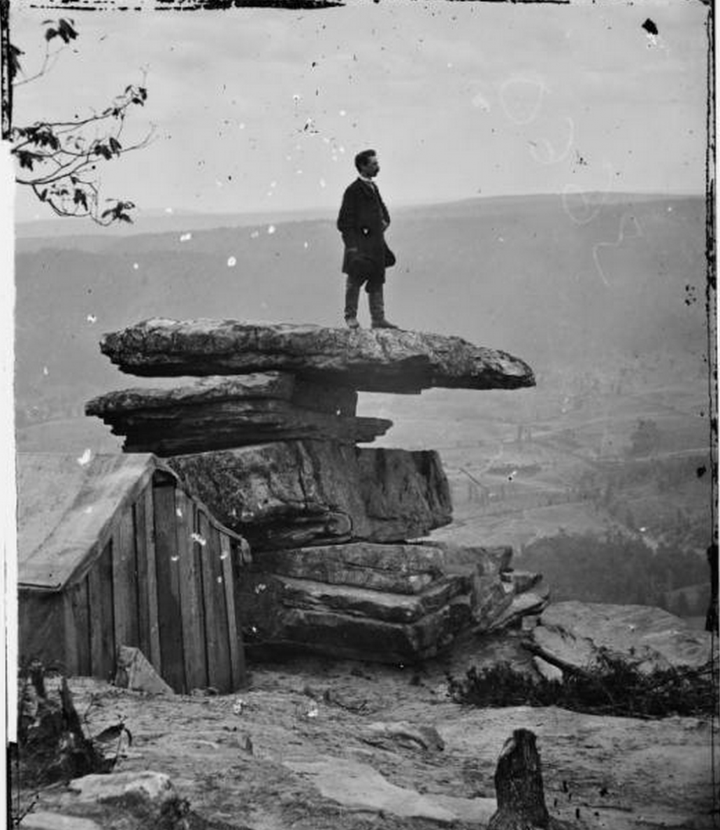 Man poses on Umbrella ROck 1864